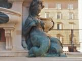 Mermaid under the statue of Neptune